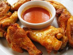 THESE ARE THE BEST? Unbelievable Baked Buffalo Wings for a healthy alternative to fried wings: The meat will fall off the bone! Gotta' have wings on sunday! Carne, Baked Buffalo Wings, Buffalo Chicken, Table D Hote, Famous Recipe, Chicken Wing Recipes, Appetizer Recipes, Delicious Appetizers, Love Food
