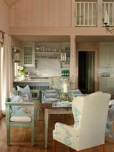 Love the bench, overstuffed chairs and wooden chair combos!