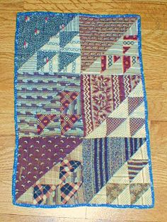 "1860's  doll quilt. It measures 9"" x 13 3/4""."