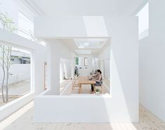 House N by Sou Fujimoto Architects. A bedroom and tatami room are encased behind the second layer, where all window openings are infilled with glass.