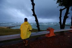 A man looks out to the sea in Puerto Plata. REUTERS/Ivan Alvarado