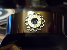 Silvertone cuff bracelet with Sapphire Blue Swarovski crystal. $35.00.