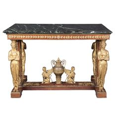 Empire Style Gilt and Patinated-Metal Mahogany Center Table  After the royal model by Georges-Alphonse Jacob-Desmalter, first half of the 20th century  The rectangular green marble top with a molded edge, raised on caryatid supports ending in an H-form plinth surmounted by an urn with flaming torch-form finial, centering an opposed pair of winged sphinxes.  The original table was supplied by Jacob-Desmalter for the bedroom of Caroline Murat at the l'Elysee Palace and was later used by…