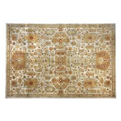 Traditional warmth and beauty make our easy-care area rug a smart choice for your home. Neutral tones create a striking pattern that looks great in a variety of rooms.