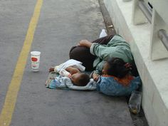 sad. #homeless #mother and #child Bangkok, Thailand.