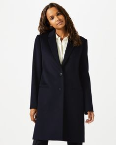 This single-breasted coat is made from a wool blend. Fully lined, it has welt pockets with flaps and full lining for a stylish drape. Other features include a contrast under collar, working button cuffs and notch lapels for a smart look. Layer over your work and casual wardrobe.