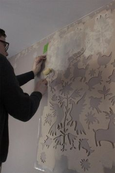 A stenciled entryway using the Otomi Allover Stencil pattern…