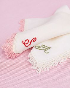 Vintage Handkerchiefs...the bride stitched her mother's and her soon to be mother-in-laws initials on the handkerchiefs and presented them during the ceremony...
