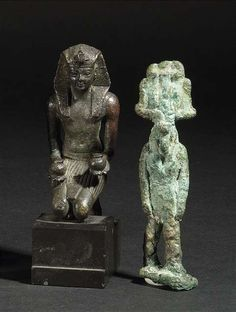 A bronze figure of a kneeling Pharao, probably late Kingdom, and a bronze Amulet figure. Egypt. - Property of an old German aristocratic collection. - The Amulet figure damaged and restored. The kneeling figure repaired at the right arm.