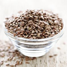 """Flaxseed contains two substances--soluable fiber and lignon--that block the production of LDL or """"bad"""" cholesterol. These substances also increase the body's ability to get rid of cholesterol. Adding ground flaxseed to smoothies or oatmeal is a great way to include this cholesterol-busting food to your diet. Top 10 Home Remedies, Home Remedies For Hair, Natural Remedies, Diet And Nutrition, Nutritious Meals, Healthy Fats, Healthy Weight, Healthy Life, Healthy Snacks"""