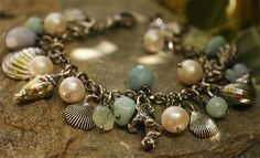 Bracelet is composed of SeaShells cast from real sea shells of the Midway Islands and Sanibel Island. The stones are natural---Freshwater Pearls,