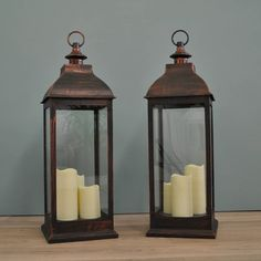two firenze battery operated candle lanterns in copper by garden selections | notonthehighstreet.com