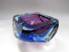 A large Murano glass Sommerso bowl in blue and amethyst cased in clear.