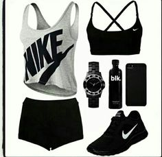 All Nike Black Sports Bra With Black Shorts And Shoes With A Grey Tank Top
