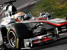 Lewis Hamilton in his McLaren Mercedes!!!!!!!! Isn't it gorgeous!!!