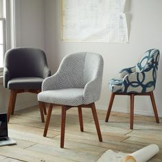 "I like these Saddle Office Chairs from West Elm - possibly one striped and one gray one for the ""office"""