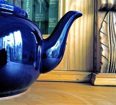 which is better georgeoua blue teapot or vibntage books>???