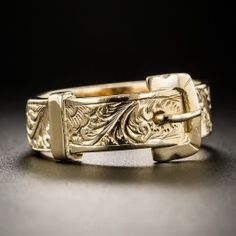 From jolly old Birmingham England, circa 1922 (according to the ample hallmarks), a classic Victorian style buckle ring hand fabricated in gleaming 18K rose gold and hand engraved all around with a charming floral design. Currently ring size 7 1/2.