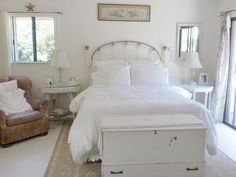 Pure white shabby chic decor with touches of beige creates romantic and elegant bedroom.