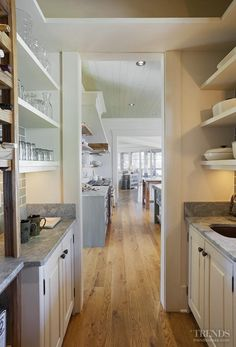 Kitchen Pantry Layout Ideas. A pantry off the kitchen provides additional storage. #Kitchen #pantry Picture via Kitchen TRENDS. Interiors by Gregory Vaughan, Kelley Designs, Inc. Photos by Atlantic Archives, Inc.