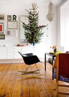 Love the idea of a smaller tree placed on top of something else. I just love this whole look. MEEEEE TOOO!!