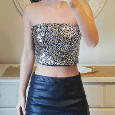 Charlotte Russe Black & Silver Sequin Crop Top Would fit size xsmall (with a strapless bra) or a size small. Like new! Has some stretch to it. Front has sequins. Back is all black. Charlotte Russe Tops Crop Tops