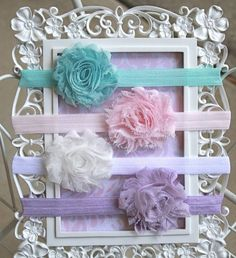 $16.00 Absolutely Darling!! These shabby chic flowers set is so delicate and sweet. In this set you will receive turquoise, light pink, white and lavender. Would make a perfect photography prop for newborn infant baby photos, weddings, special occasions or as a fashion statement. So fun for spring and summer!