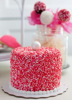 A Pink, Red and White sprinkled covered Cake for Valentine's Day by Snickety Snacks