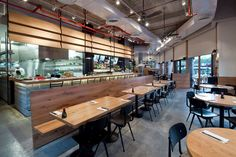 I love the industrial look Levy:Chamizer Architects studio realized for Giraffe Restaurant from Tel Aviv, Israel. As you can see from the photos below, th Thatched House, Wooden Sofa, Douglas Fir, Commercial Kitchen, Interior Design Studio, Giraffe, Concrete, Industrial, Architecture