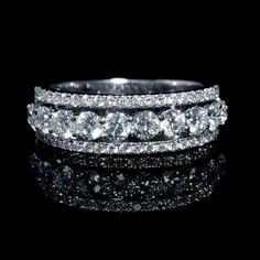 This stunning 18k white gold wedding band ring, features 54 round brilliant cut white diamonds, F color, VS2 clarity, excellent cut and brilliance, weighing 1.50 carats total.