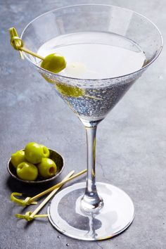 The classic dry Gin Martini contains just three simple ingredients - gin, vermouth, and either a lemon twist or olives. Learn how to make one at home.