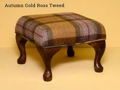Ross Tweed Autumn Gold Footstool - £120.00 (Free UK Delivery)  •Superior Ross Tweed Fabric exclusive to Flossy's. •100% British Wool – from a sustainable source. •Footstool size 32cm x 32cm. •A stunning Autumn Gold fabric. •Handmade 6″ dark wood legs, styled by our in house joiner. •Looks great in any home and interior style.