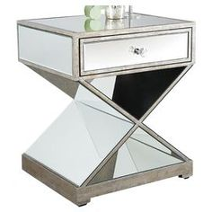 "Mirrored side table with open X-base.  Product: Side table Construction Material: Wood and mirrored glass   Color: Silver    Dimensions: 30"" H x 33"" W x 18"" D"
