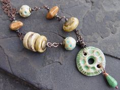 Copper Wrapped Stoneware Beads with Handmade Chain Necklace AWMember via Etsy.