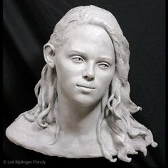 Commissioned clay portrait sculpture of a young woman ©Lori Kiplinger Pandy