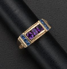 An amethyst and sapphire set in gold ring in an art deco style.