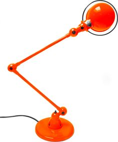 Colours Orange – Jieldé 1955: In the first brochure Jielde reveals details of his remarkable joint construction (1, 2, 3). The electricity is transported through the joints by an ingenious mechanism which eliminates the necessity of wires. In the first half of the previous century many accidents occurred due to breaking wiring, caused by the absence of durable synthetic insulation materials. #jielde #lamp #orange
