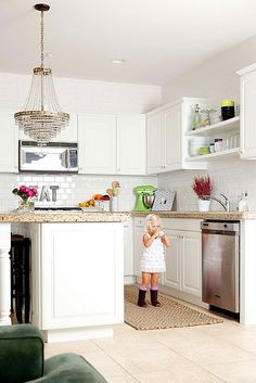 White classic kitchen --floor and counter tops a beige---nice contrast, not too bright