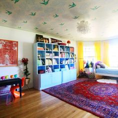The playroom of our Daydreams, for certain (via @jennykomenda - we love the blue cabinets too!)