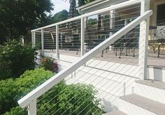 This fascia-mounted White Aluminum Cable Railing System completes a welcoming wrap-around porch with its bright coloration and open design. Wire Deck Railing, Front Porch Railings, Deck Railing Design, Metal Deck, Deck With Pergola, Pergola Shade, Pergola Ideas, Railing Ideas, Pergola Cover