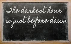 handwriting blackboard writings - The darkest hour is just before dawn Stock Photo - 12500286