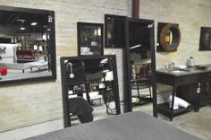 Simple steel framed mirrors...very chunky and sublime.