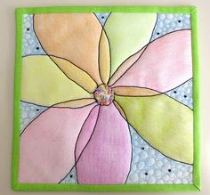 Cool technique of coloring fabric with crayons and then use as a quilt block.