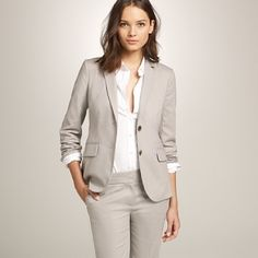 Classic women's suit, note the rolled sleeves