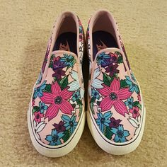 Nike Toki Slip On Pink floral print slip on.  Brand new, never worn  and with Nike box without the top of the box. Nike Shoes