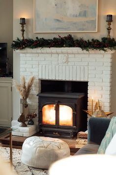 Cosy fireplace, painted white brick with a faux Christmas garland on top. Cosy Fireplace, Stove Fireplace, Eucalyptus Garland, Molton Brown, Time To Celebrate, Christmas Love, Stoves, Christmas Tree Decorations, Fireplaces