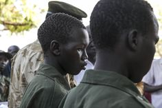 https://flic.kr/p/rPsUFH | SPLA releases two child soldiers captured to DDR | The SPLA, represented by SPLA Spokesperson, Philip Aguer, released two child soldiers being held by the Sudan People Liberation Army IO. The children were taken in Rajah on Mar. 16, 2015 and flown to Juba two days later.  They were finally handed over to the South Sudan DDR Commission, represented by Andrew Oluko Holt. Photo: UNMISS/Isaac Billy