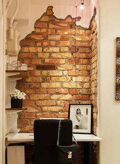 Home office design. Love the brick wall appeal.