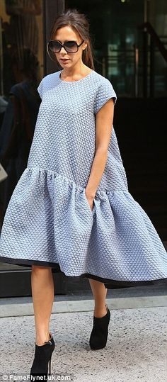 Floaty fashion: Pregnant Chloe Delevinge (L) wore the £1,500 cloud dress designed by Victoria Beckham (R) to sister Poppy's wedding in Knightsbridge on Friday