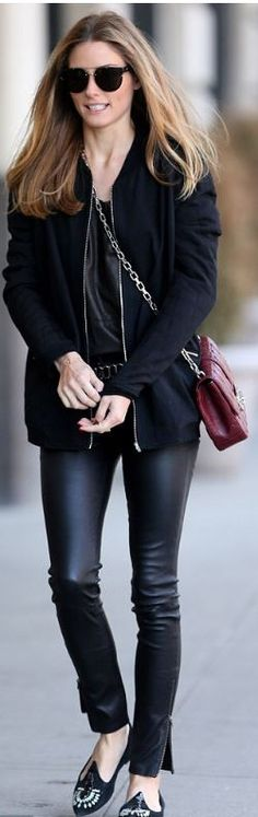 Who made Olivia Palermo's red leather handbag, black jacket, and sunglasses that she wore in New York?